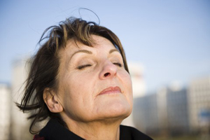 woman taking deep breath