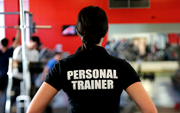 professional personal trainer in a gym